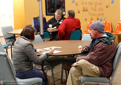 Volunteer Lauren Marsh is helping a man fill out the homeless point in time survey January 25, 2017 at the Hope Center in Oroville, California. (Emily Bertolino -- Mercury Register)