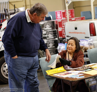 Oroville point in time coordinator Carol Zanon collects survey's from volunteer Dave Dowlen January 25, 2017 at the Hope Center in Oroville, California. (Emily Bertolino -- Mercury Register)