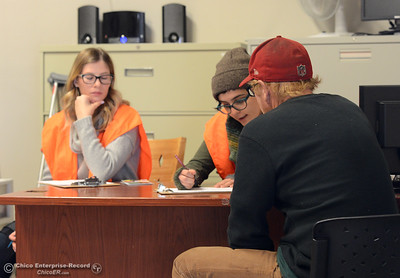 Rio Gardner, left, and Sara Whitchurch help a man take homeless point in time survey Wednesday, Jan. 25, 2017, in Chico, California. Homeless people took the surveys all over the Butte County from 8 a.m. to 6 p.m. (Dan Reidel -- Enterprise-Record)