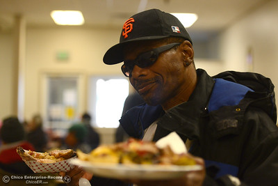 Victor Wyatt smiles while taking his lunch to a table Wednesday, Jan. 25, 2017, at the Jesus Center in Chico, California. Homeless people took the point in time surveys all over the Butte County from 8 a.m. to 6 p.m. and the Jesus Center offered a special lunch of chicken wings, nachos and ribs for those who took the survey. (Dan Reidel -- Enterprise-Record)