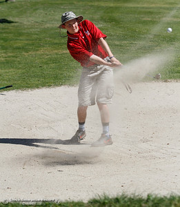 Las Plumas's Peyton Sherwood chips his way out of a sand trap during the Butte View golf meet Wednesday April 6, 2016 at Table Mountain Golf Course in Oroville, Calif. (Emily Bertolino -- Enterprise-Record)