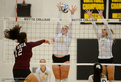 Butte #11 Riley Lemons and #7 Anna Dugo get up to block a shot by DeAnza's Karina Lucero during Butte vs DeAnza College Volleyball at Butte, Tuesday, Sept. 18, 2018.  (Bill Husa -- Enterprise-Record)