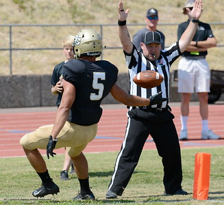 Butte #5 Dalton Gee gives a referee the ball after scoring a touchdown during Butte vs Delta football at Cowan Stadium in Chico, Calif. Saturday Sept. 1, 2018. (Bill Husa -- Enterprise-Record)