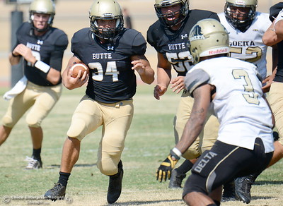 Butte #34 Jackson Taylor looks for room to run during Butte vs Delta football at Cowan Stadium in Chico, Calif. Saturday Sept. 1, 2018. (Bill Husa -- Enterprise-Record)