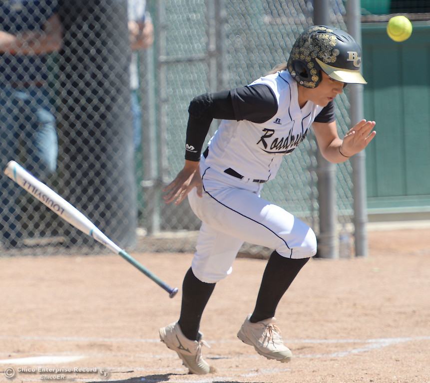 . Butte #2 Jolynn Kelly heads for first on a slow dribbler during the first game of a doubleheader Butte vs Feather River College softball Friday April 20, 2018. (Bill Husa -- Enterprise-Record)