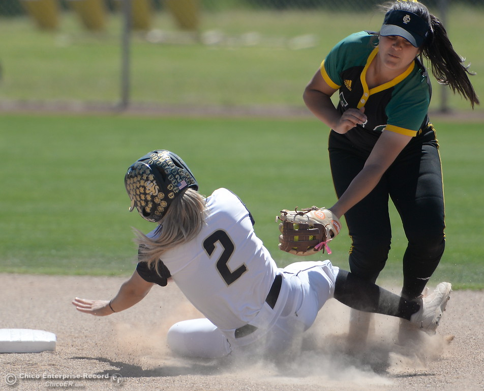 . Butte #2 Jolynn Kelly is called out on this play at second base during the first game of a doubleheader Butte vs Feather River College softball Friday April 20, 2018. (Bill Husa -- Enterprise-Record)