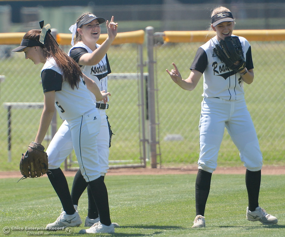 . The outfielders have their own pre-inning routine during the first game of a doubleheader Butte vs Feather River College softball Friday April 20, 2018. (Bill Husa -- Enterprise-Record)