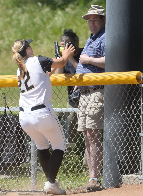 . First baseman #22 Rylie Loflin makes a nice catch for an out by the fence during the first game of a doubleheader Butte vs Feather River College softball Friday April 20, 2018. (Bill Husa -- Enterprise-Record)