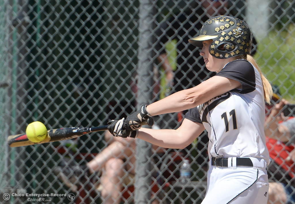 . Butte #11 Bailee Robicheau gets her bat on the ball during the first game of a doubleheader Butte vs Feather River College softball Friday April 20, 2018. (Bill Husa -- Enterprise-Record)