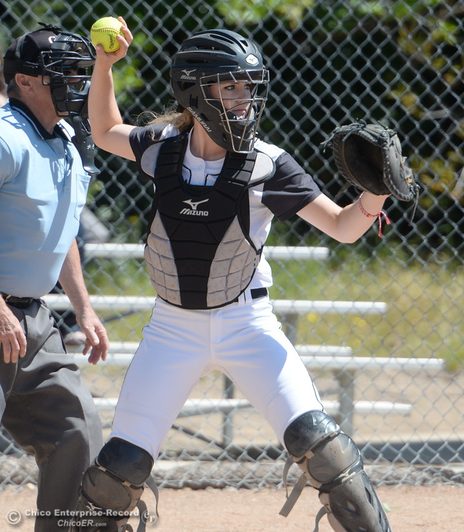 . Butte catcher Monica Deadmond comes up throwing during the first game of a doubleheader Butte vs Feather River College softball Friday April 20, 2018. (Bill Husa -- Enterprise-Record)