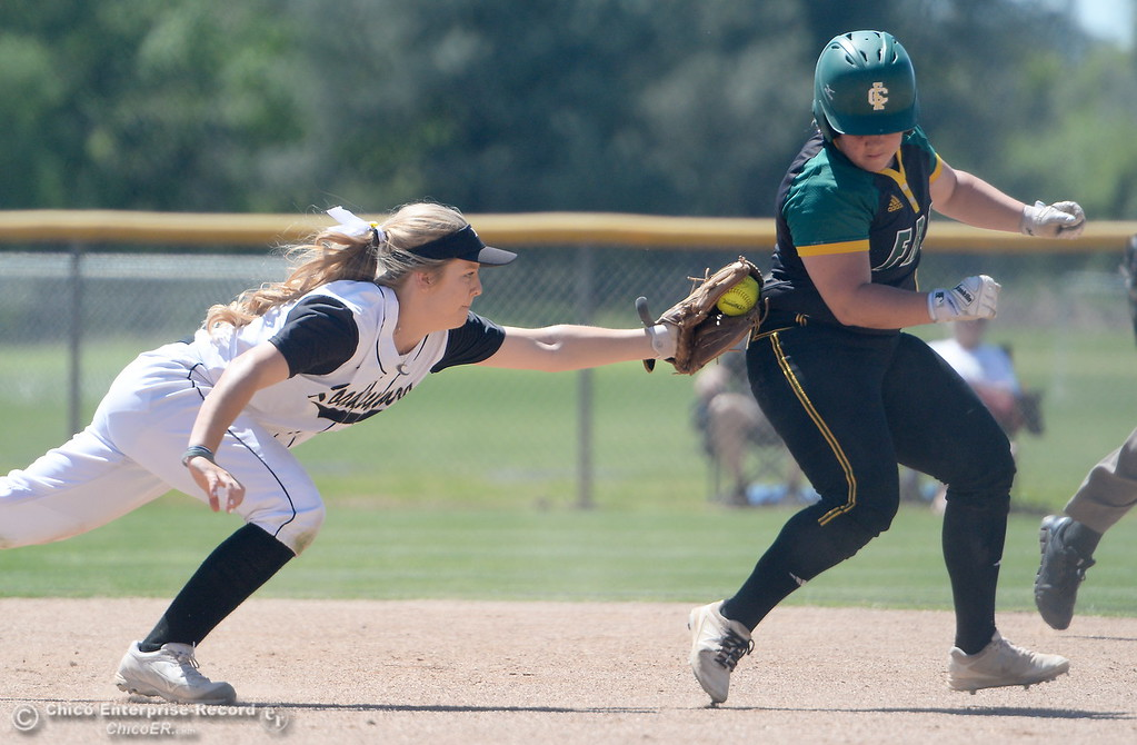 . Butte shortstop Baylie Fryar gets the tag on Feather Rivers Payton Reynolds as Reynolds gets caught between first and second base during the first game of a doubleheader Butte vs Feather River College softball Friday April 20, 2018. (Bill Husa -- Enterprise-Record)