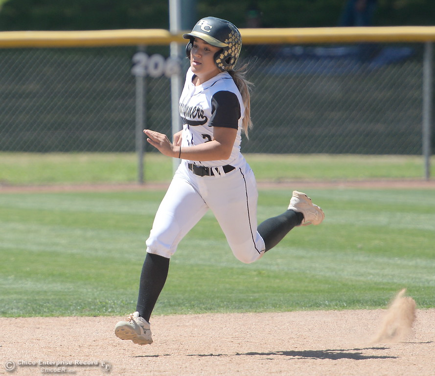 . Butte #2 Jolynn Kelly heads for second on a throwing error at first during the first game of a doubleheader Butte vs Feather River College softball Friday April 20, 2018. (Bill Husa -- Enterprise-Record)