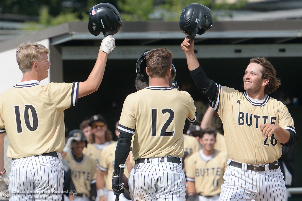 . Butte #26 Ryan Gamboa gets greeted at the plate after he continues the home run derby in the 3rd inning during Butte vs Monterey baseball at Butte College in Chico, Calif. Tuesday May, 1, 2018.   (Bill Husa -- Enterprise-Record)