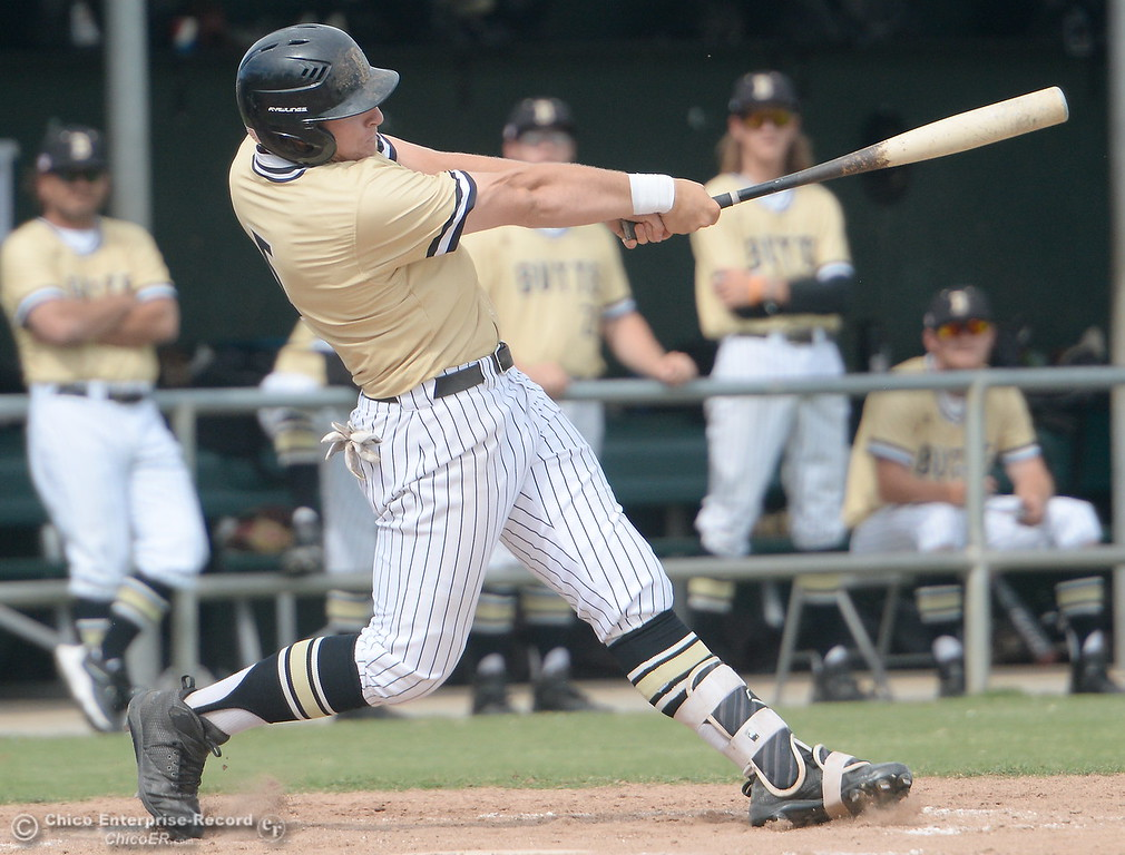 . Butte #5 Connor Blair gets all of this pitch as he rips a home run over the left field fence during Butte vs Monterey baseball at Butte College in Chico, Calif. Tuesday May, 1, 2018.   (Bill Husa -- Enterprise-Record)