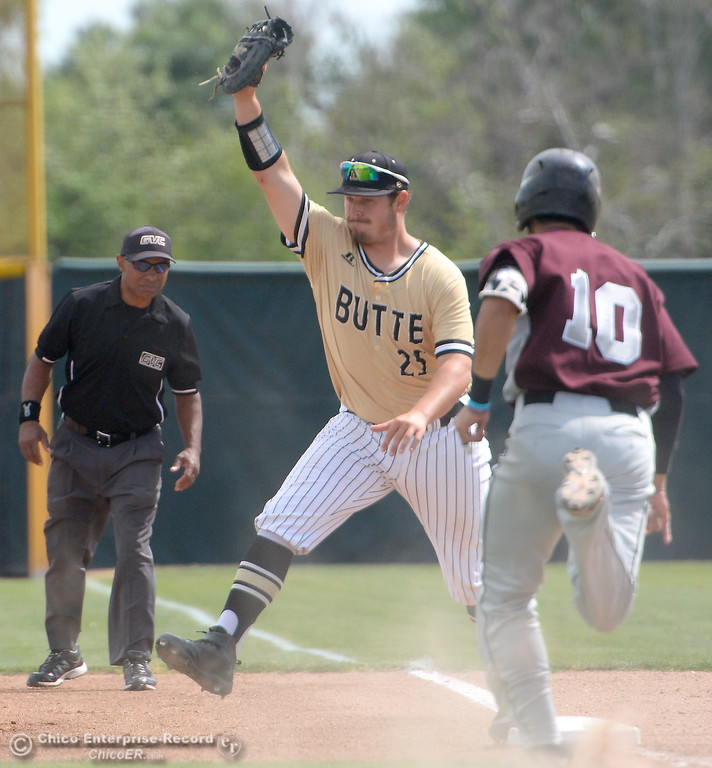 . Butte First baseman #25 Walker Dodero squeezes the ball for the out against Monterey #10 Gavin Jarvis during Butte vs Monterey baseball at Butte College in Chico, Calif. Tuesday May, 1, 2018.   (Bill Husa -- Enterprise-Record)