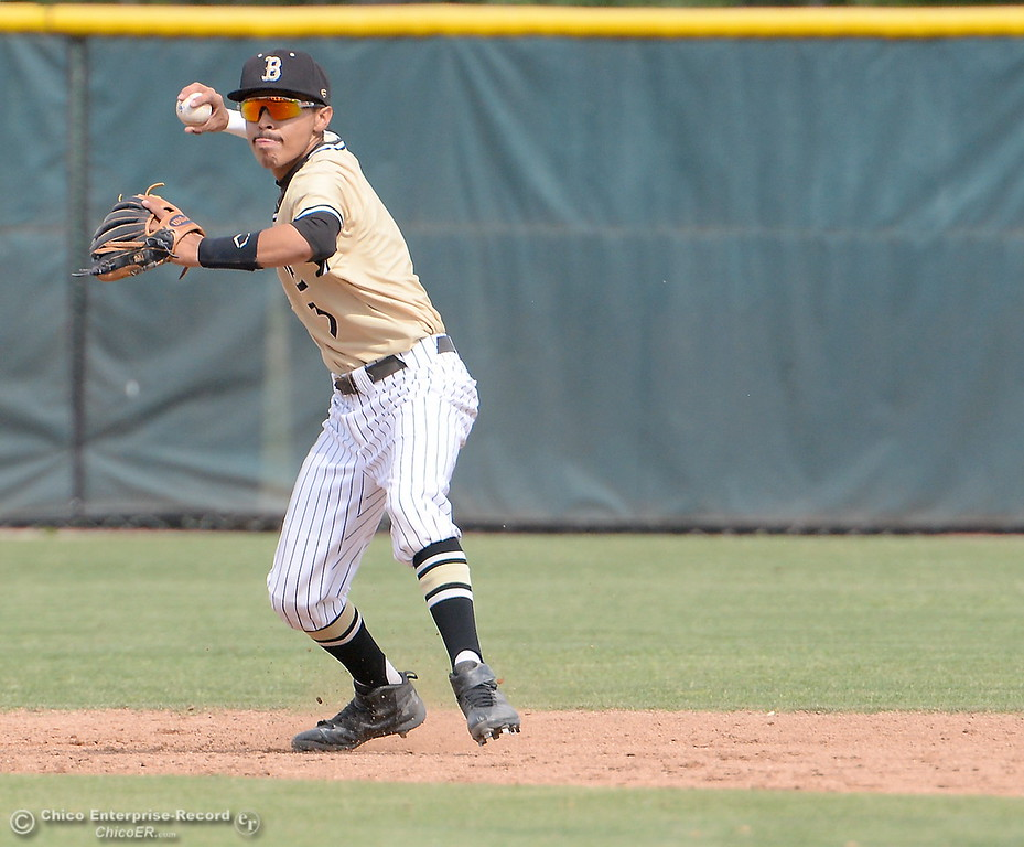 . Butte Shortstop #Eric Robles makes a play on an infield grounder during Butte vs Monterey baseball at Butte College in Chico, Calif. Tuesday May, 1, 2018.   (Bill Husa -- Enterprise-Record)