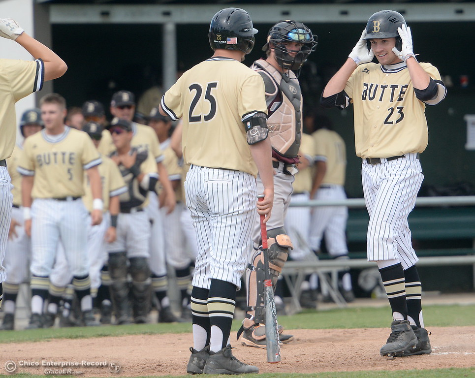 . Butte #23 is greeted at the plate following his second home run on the day during Butte vs Monterey baseball at Butte College in Chico, Calif. Tuesday May, 1, 2018.   (Bill Husa -- Enterprise-Record)