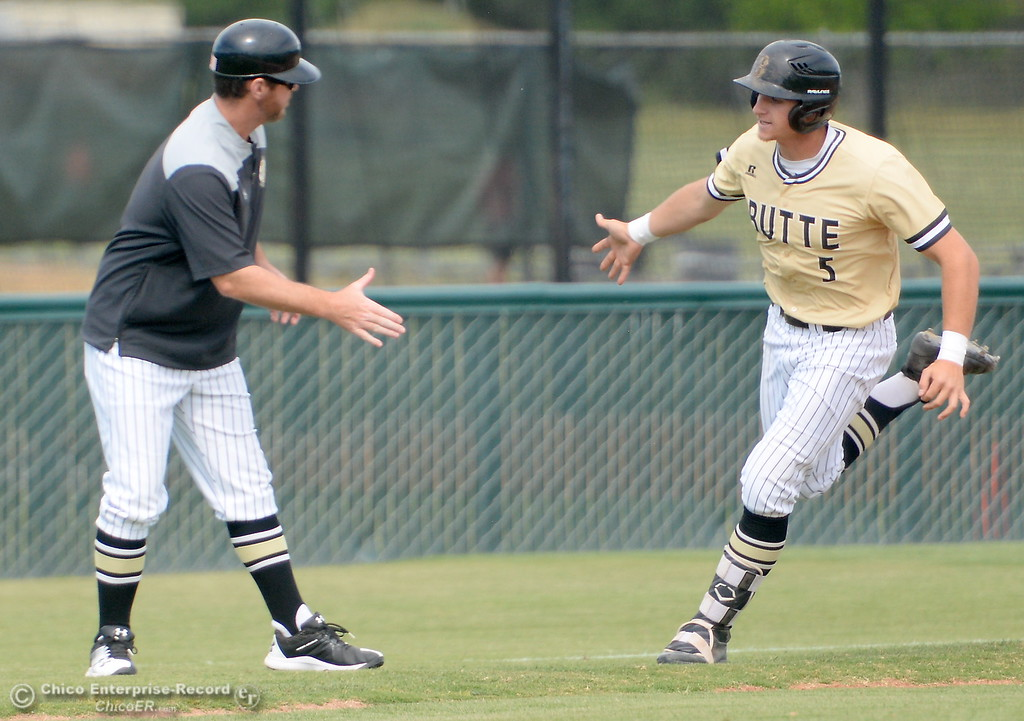 . Butte #5 Connor Blair gets high fives all around after he rips a home run over the left field fence during Butte vs Monterey baseball at Butte College in Chico, Calif. Tuesday May, 1, 2018.   (Bill Husa -- Enterprise-Record)