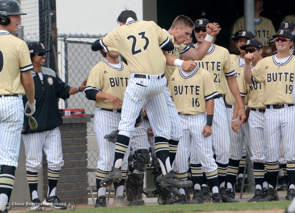 . The duggout is hopping with excitement after back to back home runs by Connor Blair and Lane Pritchard during Butte vs Monterey baseball at Butte College in Chico, Calif. Tuesday May, 1, 2018.   (Bill Husa -- Enterprise-Record)