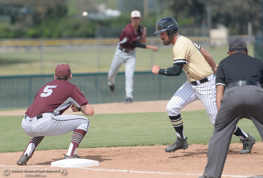 . Butte #12 Kasey Buchanan gets back to the bag safely on a pickoff attempt during Butte vs Monterey baseball at Butte College in Chico, Calif. Tuesday May, 1, 2018.   (Bill Husa -- Enterprise-Record)