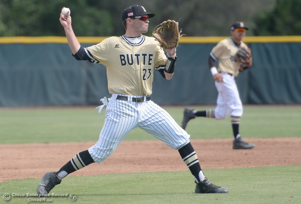 . Butte #23 Lane Pritchard makes a play on an infield grounder during Butte vs Monterey baseball at Butte College in Chico, Calif. Tuesday May, 1, 2018.   (Bill Husa -- Enterprise-Record)