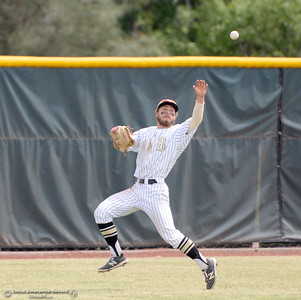 Butte left fielder Matt Kirtley just misses a bare hand grab  of a bouncing ball in the outfield during Butte vs Redwoods baseball at Butte College Thurs. April 21, 2016. (Bill Husa -- Enterprise-Record)