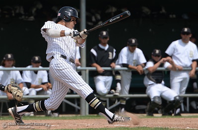 Butte #27 Jesse Morales rips a single into center field in the bottom of the fourth inning of the first game of a double header during Butte vs Redwoods baseball at Butte College Thurs. April 21, 2016. (Bill Husa -- Enterprise-Record)