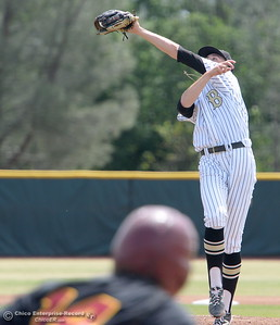 Butte Pitcher #4 Tevin Cadola makes a nice grab on a hot shot back up the middle by Redwoods #14 Christian Halterman during Butte vs Redwoods baseball at Butte College Thurs. April 21, 2016. (Bill Husa -- Enterprise-Record)
