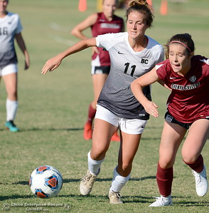 Butte #11 Rachel Sites battles a Sierra defender during Butte College vs Sierra College womens soccer at Butte College in Chico, Calif. Thurs. Sept. 6, 2018.  (Bill Husa -- Enterprise-Record)