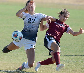 Butte #22 Brooke Parks gets tangled up with Sierra #8 Christina Kanellou as they battle for a ball during Butte College vs Sierra College womens soccer at Butte College in Chico, Calif. Thurs. Sept. 6, 2018.  (Bill Husa -- Enterprise-Record)