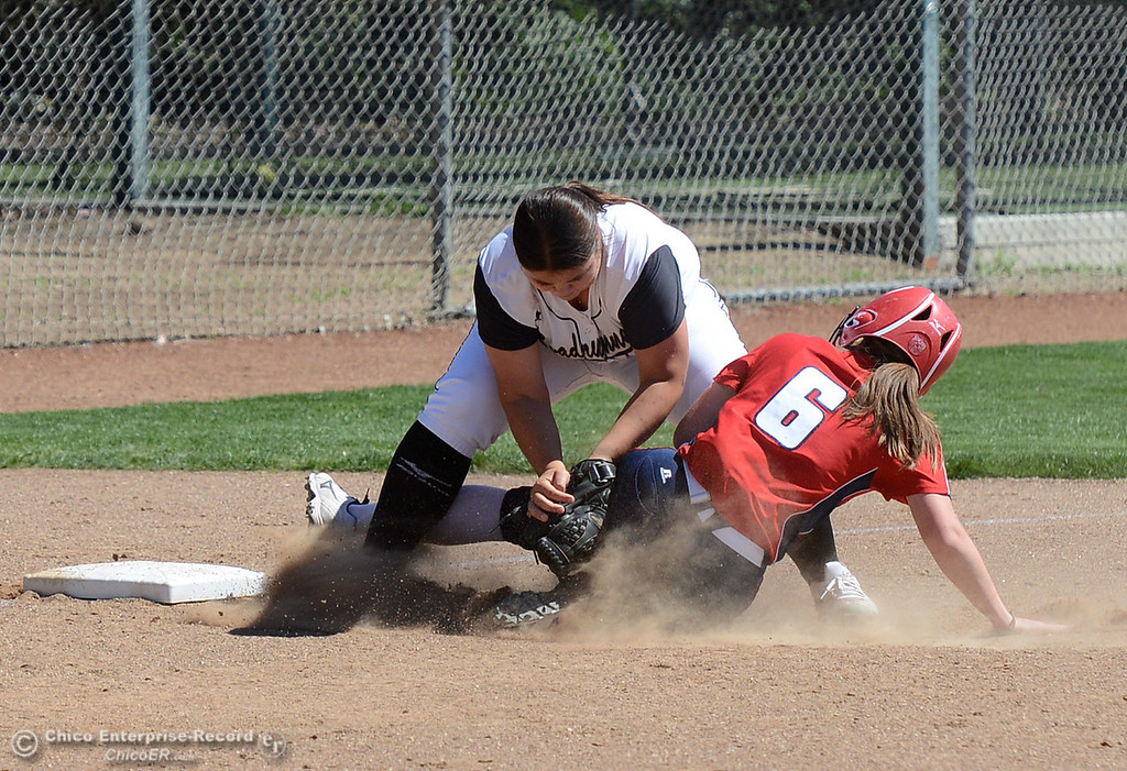 . Butte College third baseman Halle Brown tags out Siskiyous player Kari Prockish (6) as the Butte College Roadrunners play College of the Siskiyous in the first half of a doubleheader Friday, March 31, 2017, in Butte Valley, California. (Dan Reidel -- Enterprise-Record)