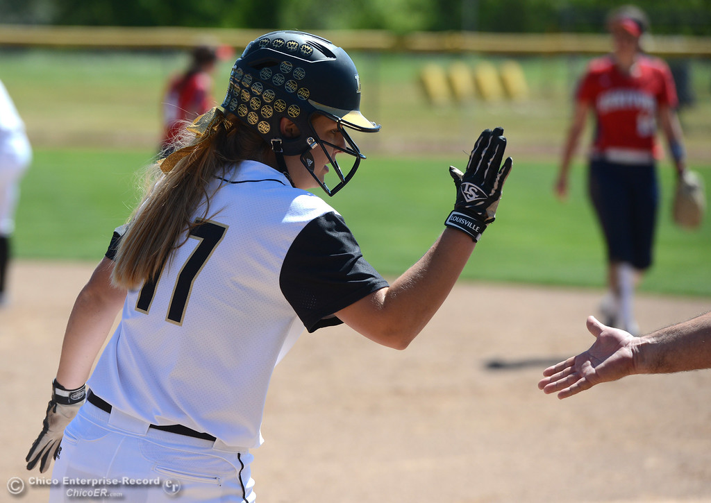 . Baylie Fryar slaps hands with her coach after a hit as the Butte College Roadrunners play College of the Siskiyous in the first half of a doubleheader Friday, March 31, 2017, in Butte Valley, California. (Dan Reidel -- Enterprise-Record)