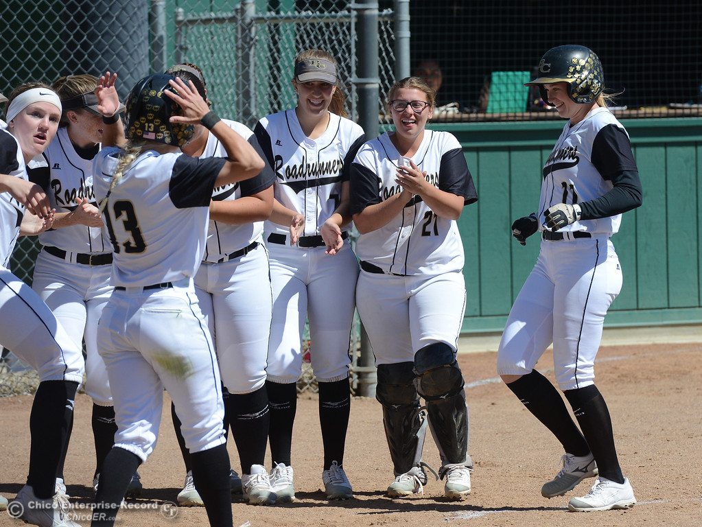 . Bailee Robicheau, right, is celebrated by her teammates at the plate after smacking a two-run homerun over the left center field fence as the Butte College Roadrunners play College of the Siskiyous in the first half of a doubleheader Friday, March 31, 2017, in Butte Valley, California. (Dan Reidel -- Enterprise-Record)