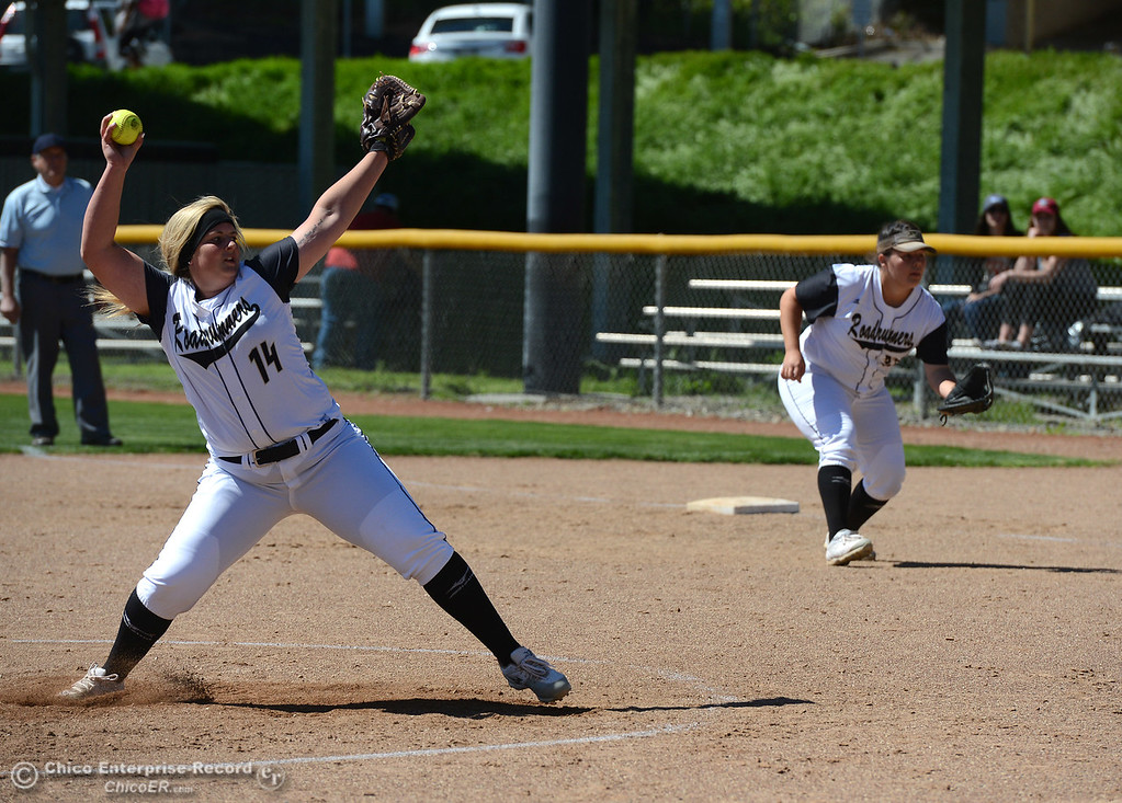 . Pitcher Baylee Thayer, left, delivers as Hillary Wilhite, right, plays first base as the Butte College Roadrunners play College of the Siskiyous in the first half of a doubleheader Friday, March 31, 2017, in Butte Valley, California. (Dan Reidel -- Enterprise-Record)