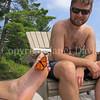 Monarch Butterfly Tasting Salt From Sweat on Man's Toe 7