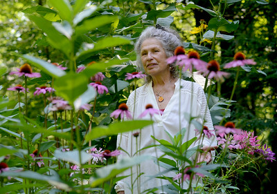 Tania Barricklo- Daily Freeman  Maraleen Manos-Jones stands in one of her butterfly gardens at her home in Shokan where she will be giving a butterfly/pollinator garden tour this Sunday, August 13from 4-6pm. Experience the gardens with a walk through a labyrinth, sip iced garden tea and nibble on butterfly cookies while listening to an illustrated talk and learning how you can help protect all pollinators. Reservations can be made at mmjbutterfly@hvc.rr.com or 845-657-8073 .The cost  is $10  per person . Visit her websitre at SpiritofButterfies.com