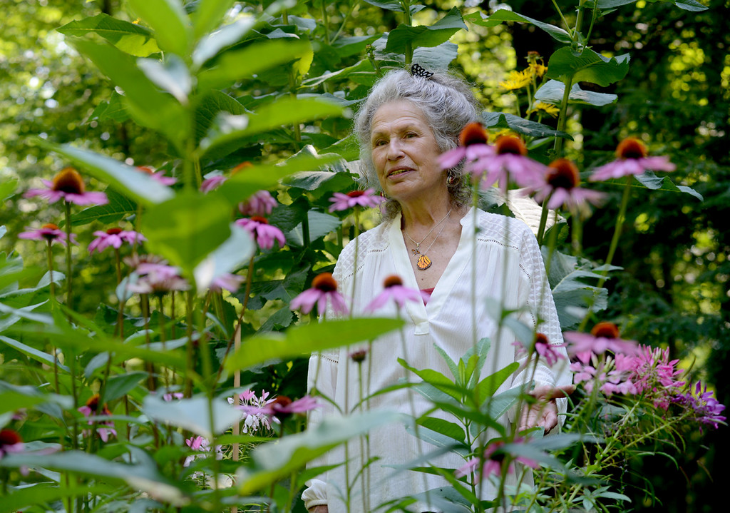 . Tania Barricklo- Daily Freeman  Maraleen Manos-Jones stands in one of her butterfly gardens at her home in Shokan where she will be giving a butterfly/pollinator garden tour this Sunday, August 13from 4-6pm. Experience the gardens with a walk through a labyrinth, sip iced garden tea and nibble on butterfly cookies while listening to an illustrated talk and learning how you can help protect all pollinators. Reservations can be made at mmjbutterfly@hvc.rr.com or 845-657-8073 .The cost  is $10  per person . Visit her websitre at SpiritofButterfies.com