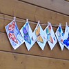 Butterfly postcards colored by people and hanging in the wall of the reception center.