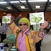 Kitty showing off her colored butterflies postcard.