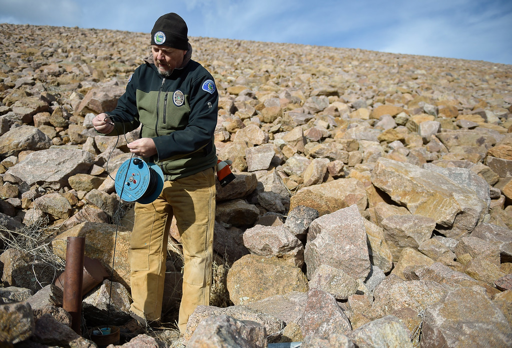 . LYONS, CO - FEBRUARY 28: City of Longmont watershed ranger Jamie Freel sends a measuring device down a piezometer, a vertical pipe in Button Rock Dam, to check the condition of the dam February 28, 2019. There are about a dozen piezometers placed throughout the dam, Freel checks them once a month. To view more photos visit timescall.com. (Photo by Lewis Geyer/Staff Photographer)