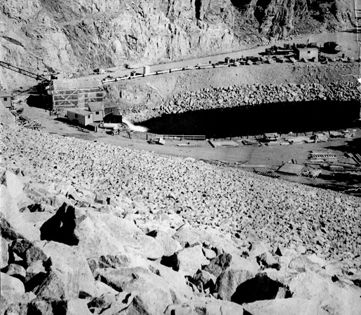 . From the Times-Call photo archive via Longmont Museum: Downstream view shows the outlet works and tailrace forming stilling basin at foot of dam. Photo from 1969. (Longmont Times-Call File/Longmont Museum)