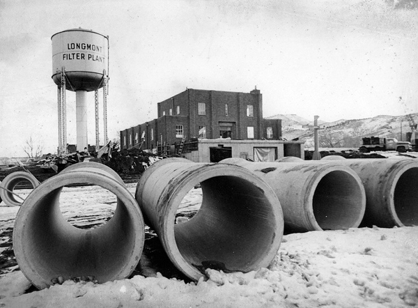 . From the Times-Call photo archive via Longmont Museum: Pieces of huge concrete pipe, which by this summer will carry water from Longmont\'s two treatment plants to the city\'s storage tank on Colorado 66, await installation near the old filter plant. Photo from 1972. (Longmont Times-Call File/Longmont Museum)