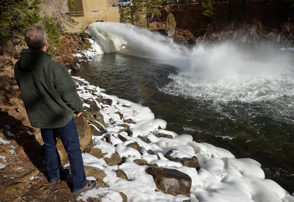 . LYONS, CO - FEBRUARY 28: City of Longmont Water Resources manager Ken Huson watches water flow from Ralph Price Reservoir, through the control house at the base of Button Rock Dam and into the North St. Vrain February 28, 2019. To view more photos visit timescall.com. (Photo by Lewis Geyer/Staff Photographer)