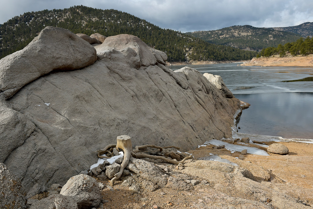 . LYONS, CO - FEBRUARY 28: A rock outcropping in Ralph Price Reservoir February 28, 2019. To view more photos visit timescall.com. (Photo by Lewis Geyer/Staff Photographer)