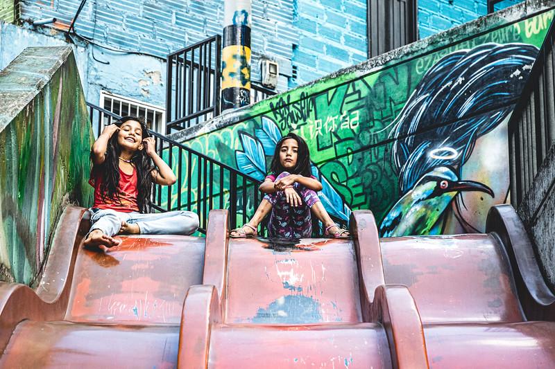 Girls Resting on Slide