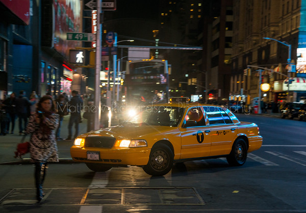 Ford Crown Victoria Yellow cab driving on West 49th St, New York City, USA