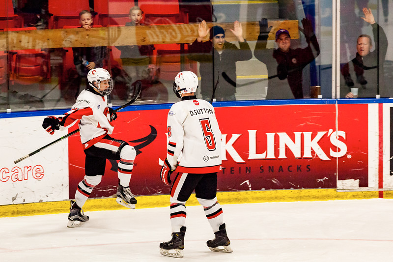 December 31, 2016 - Mac's Midget Tournament, Max Bell Centre, Calgary, Alberta - Male Division Semi-Final - Cariboo Cougars vs. Belarus National U17 - Cougars players #5 Devin Sutton and #18 Trey Thomas celebrate a goal.