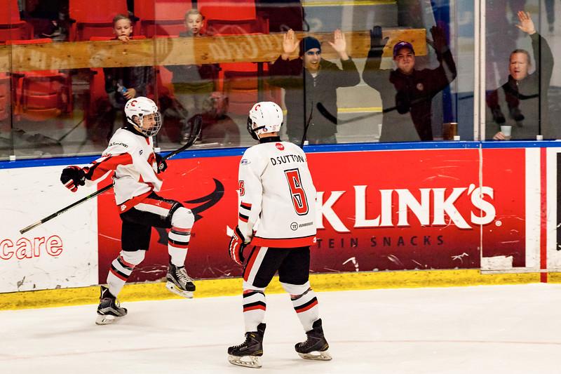 December 31, 2016 - Mac's Midget Tournament, Max Bell Centre, Calgary, Alberta - Male Division Semi-Final - Cariboo Cougars vs. Belarus National U17 - Cougars players #5 Devin Sutton and #18 Trey Thomas celebrate a goal.