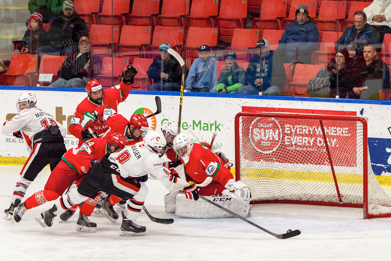 December 31, 2016 - Mac's Midget Tournament, Max Bell Centre, Calgary, Alberta - Male Division Semi-Final - Cariboo Cougars vs. Belarus National U17 - Cougars forward #8 Tyler Maser outreaches all Belarus players to put the puck past Belrus Goalie #1 ANDREI GRISHENKO.