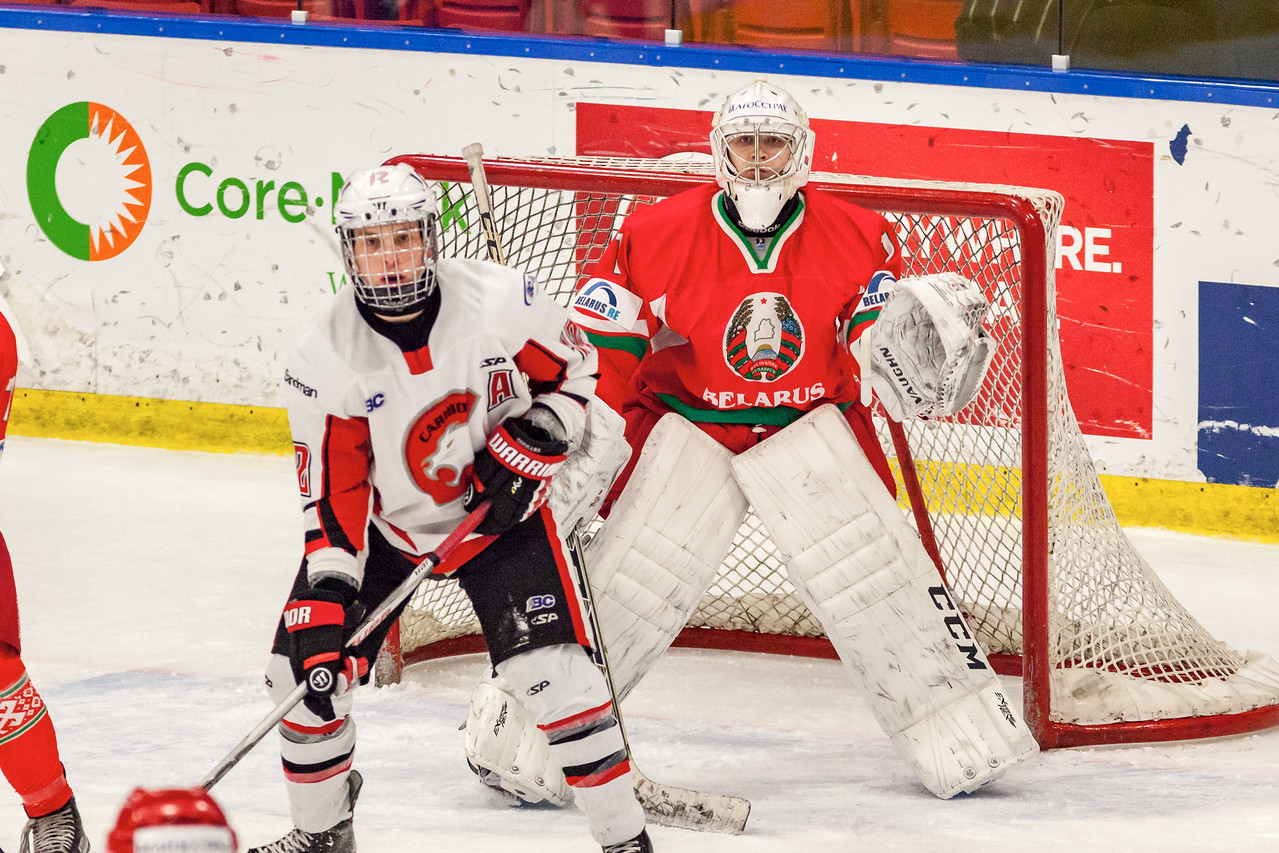 December 31, 2016 - Mac's Midget Tournament, Max Bell Centre, Calgary, Alberta - Male Division Semi-Final - Cariboo Cougars vs. Belarus National U17 - Belrus Goalie #1 ANDREI GRISHENKO and Cougars forward #12 Myles Mattila.